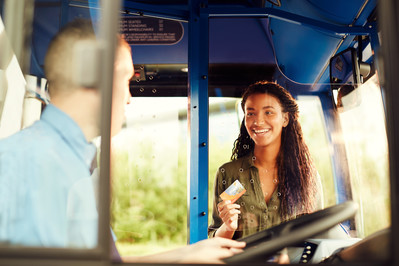 Happy girl boarding with StagecoachSmart card