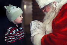 A small child talks to Santa