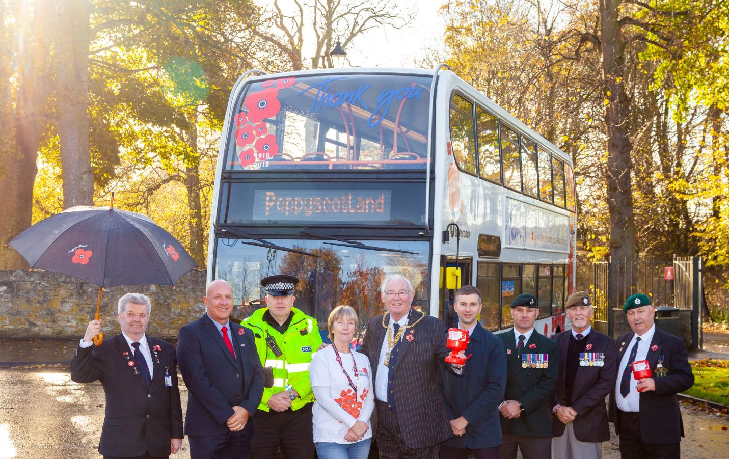 Volunteers from Poppyscotland with Lord Provost Jim Leishman beside the Poppy bus