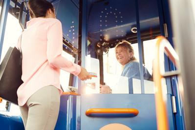 Stagecoach bus driver with customer
