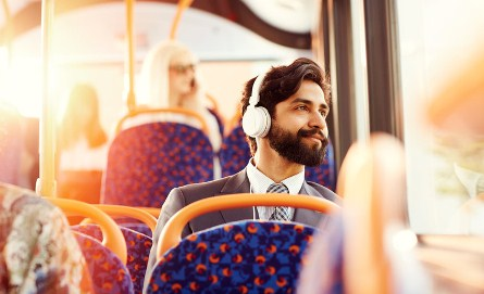 image for commuter listening to music