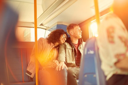 image of couple on bus