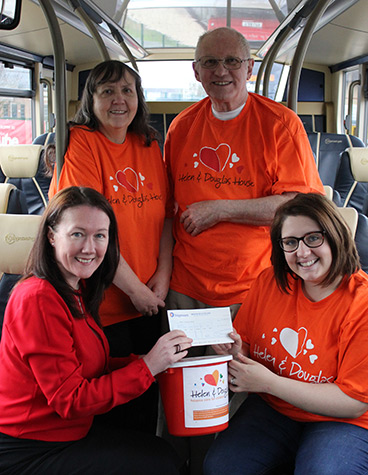 Stagecoach presents cheque to Helen and Douglas House